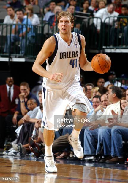 Dirk Nowitzki of the Dallas Mavericks dribbles the ball up the court against the San Antonio Spurs on October 26 2004 at the American Airlines Center...