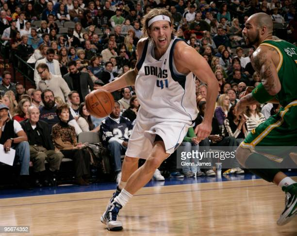 Dirk Nowitzki of the Dallas Mavericks drives against Carlos Boozer of the Utah Jazz during a game at the American Airlines Center on January 9 2010...