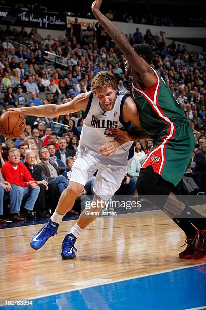 Dirk Nowitzki of the Dallas Mavericks drives against Larry Sanders of the Milwaukee Bucks on February 26 2013 at the American Airlines Center in...