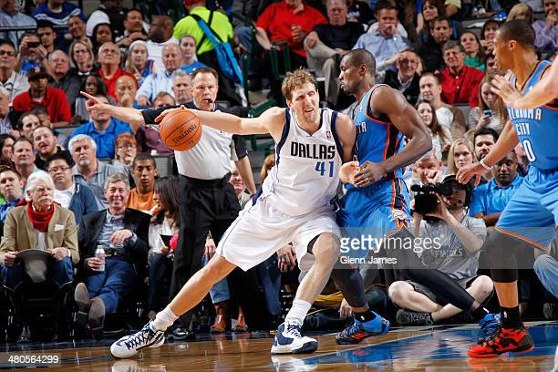 Dirk Nowitzki of the Dallas Mavericks drives against Serge Ibaka of the Oklahoma City Thunder on March 25 2014 at the American Airlines Center in...