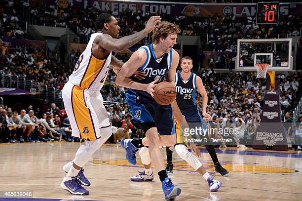 Dirk Nowitzki of the Dallas Mavericks drives against Tarik Black of the Los Angeles Lakers on March 8 2015 in Los Angeles California NOTE TO USER...