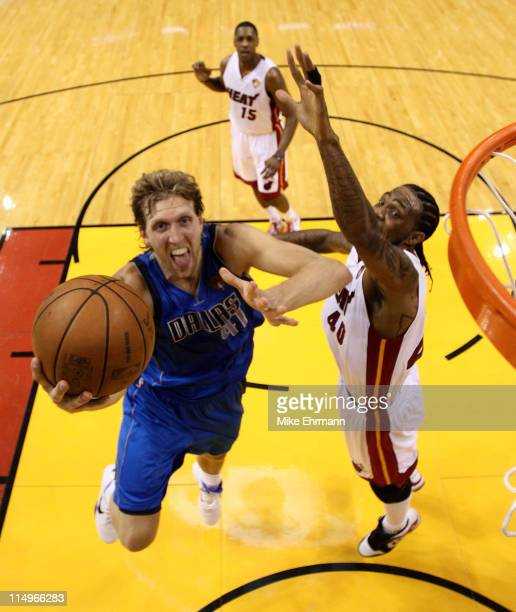 Dirk Nowitzki of the Dallas Mavericks drives for a shot attempt against Udonis Haslem of the Miami Heat in Game One of the 2011 NBA Finals at...