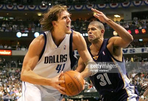 Dirk Nowitzki of the Dallas Mavericks drives the ball against Shane Battier of the Memphis Grizzlies in game two of the Western Conference...