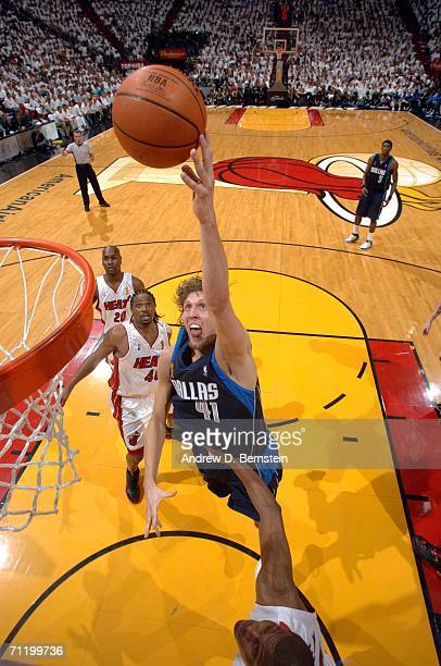 Dirk Nowitzki of the Dallas Mavericks drives to the basket against the Miami Heat during Game Three of the 2006 NBA Finals June 13 2006 at American...