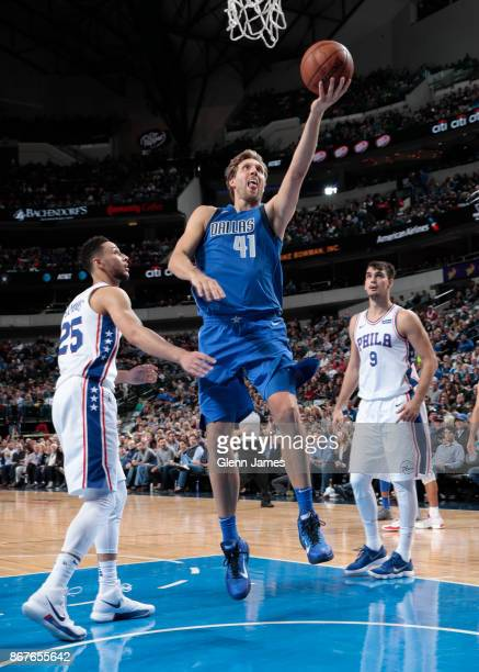 Dirk Nowitzki of the Dallas Mavericks drives to the basket against the Philadelphia 76ers on October 28 2017 at the American Airlines Center in...