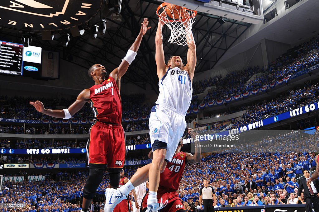 Dirk Nowitzki #41 of the Dallas Mavericks dunks against Chris Bosh #1 of the Miami Heat during Game Three of the 2011 NBA Finals on June 5, 2011 at the American Airlines Center in Dallas, Texas.