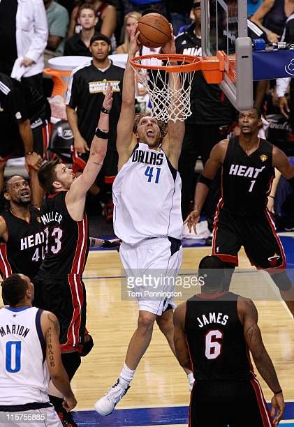 Dirk Nowitzki of the Dallas Mavericks dunks against Mike Miller and LeBron James of the Miami Heat late in the fourth quarter in Game Five of the...