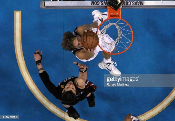 Dirk Nowitzki of the Dallas Mavericks dunks against Mike Miller of the Miami Heat late in the fourth quarter in Game Five of the 2011 NBA Finals at...