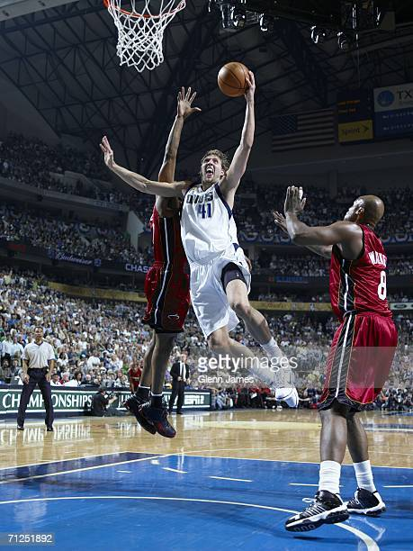Dirk Nowitzki of the Dallas Mavericks dunks against the Miami Heat during Game Six of the 2006 NBA Finals on June 20 2006 at the American Airlines...