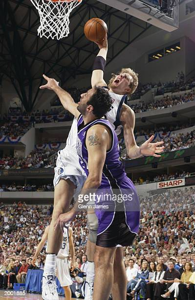 Dirk Nowitzki of the Dallas Mavericks dunks over Vlade Divac of the Sacramento Kings in Game one of the Western Conference Semifinals during the 2003...