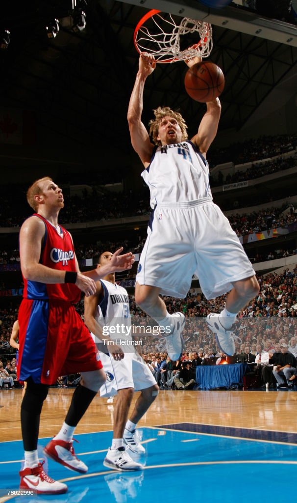 Dirk Nowitzki #41 of the Dallas Mavericks dunks the ball against the Los Angeles Clippers on December 21, 2007 at the American Airlines Center in Dallas, Texas.