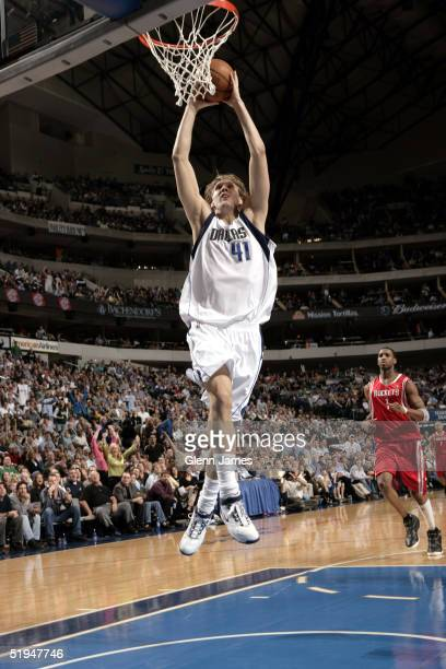 Dirk Nowitzki of the Dallas Mavericks dunks the ball against the Houston Rockets on January 12 2005 at the American Airlines Center in Dallas Texas...