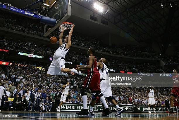 Dirk Nowitzki of the Dallas Mavericks dunks the ball in the first quarter of game six of the 2006 NBA Finals against the Miami Heat on June 20 2006...