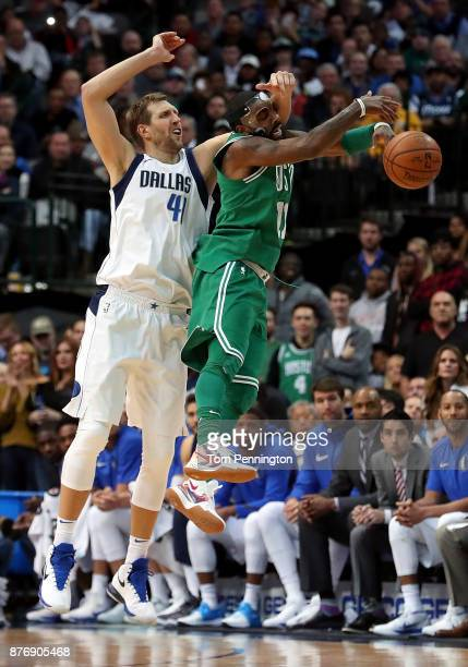Dirk Nowitzki of the Dallas Mavericks fouls Kyrie Irving of the Boston Celtics at American Airlines Center on November 20 2017 in Dallas Texas NOTE...