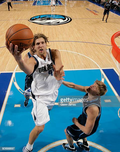 Dirk Nowitzki of the Dallas Mavericks goes in for the layup against Andrei Kirilenko of the Utah Jazz during a game at the American Airlines Center...