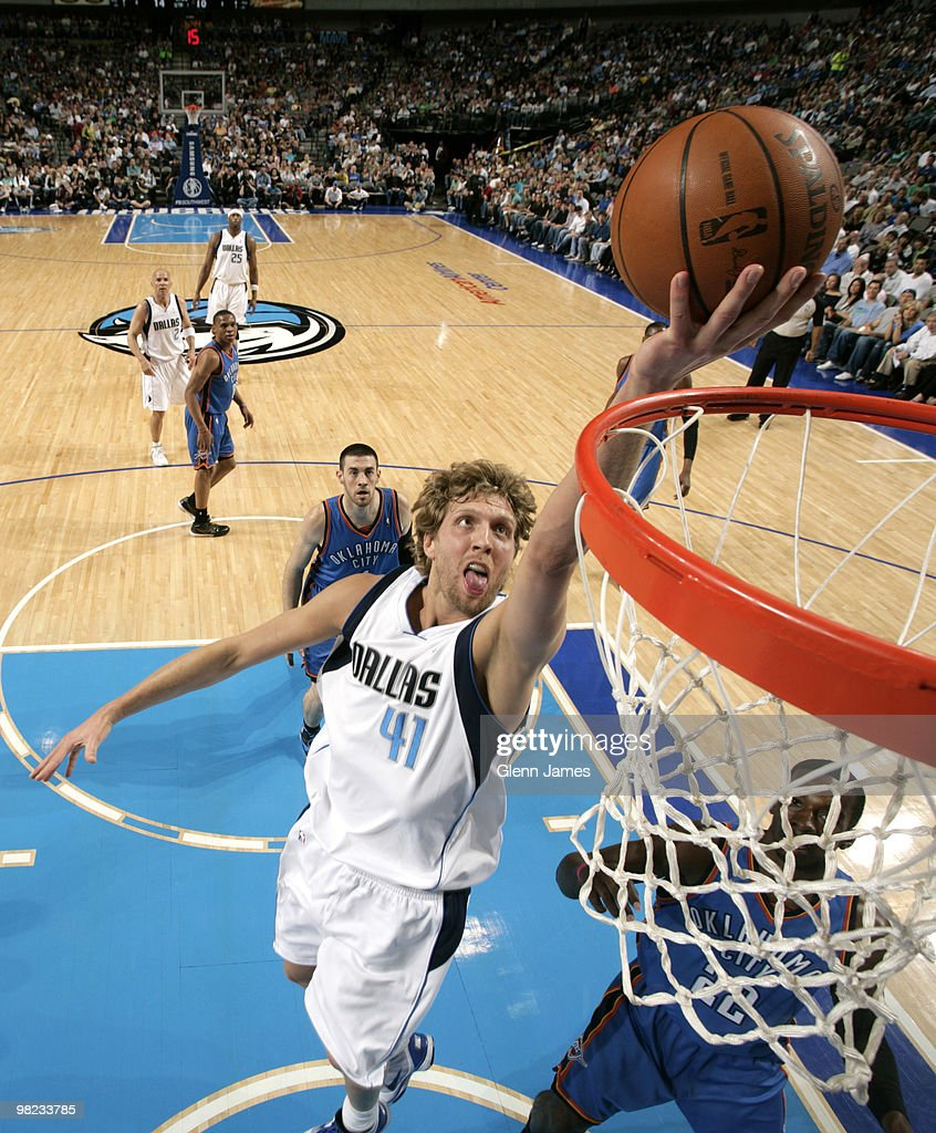 Dirk Nowitzki #41 of the Dallas Mavericks goes in for the layup against Jeff Green #22 of the Oklahoma City Thunder during a game at the American Airlines Center on April 3, 2010 in Dallas, Texas.