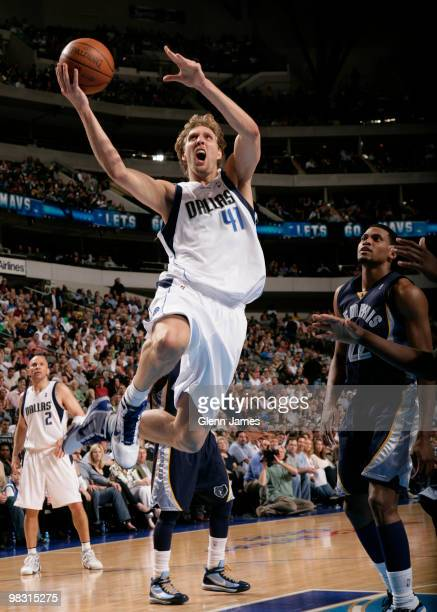 Dirk Nowitzki of the Dallas Mavericks goes in for the layup against Rudy Gay of the Memphis Grizzlies during a game at the American Airlines Center...