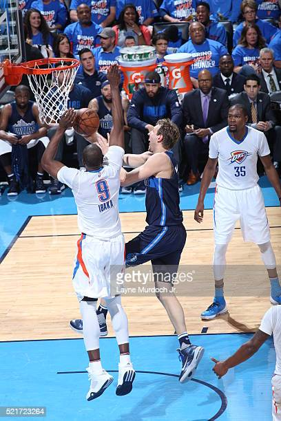 Dirk Nowitzki of the Dallas Mavericks goes to the basket against Serge Ibaka of the Oklahoma City Thunder in Game One of the Western Conference...