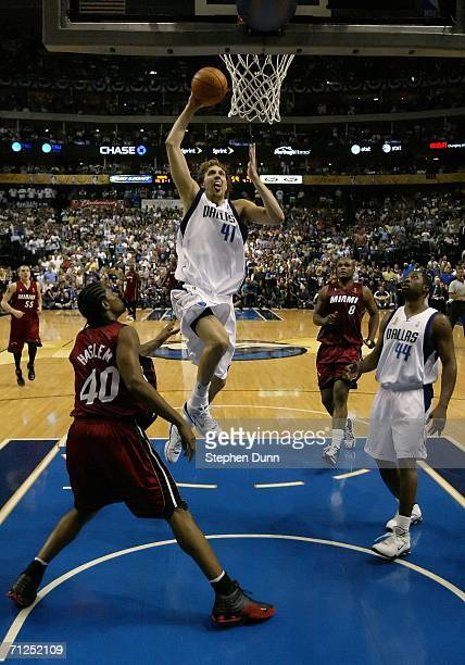 Dirk Nowitzki of the Dallas Mavericks goes up for a dunk over Udonis Haslem of the Miami Heat in the second half of game six of the 2006 NBA Finals...