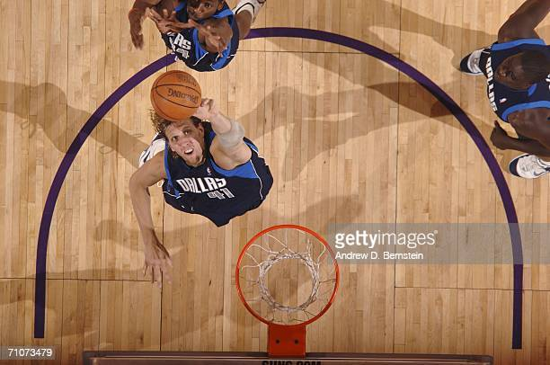 Dirk Nowitzki of the Dallas Mavericks goes up for a rebound against the Phoenix Suns in game three of the Western Conference Finals during the 2006...