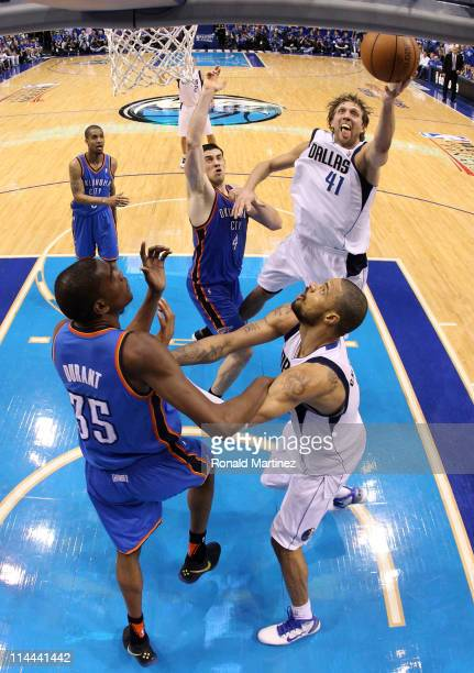 Dirk Nowitzki of the Dallas Mavericks goes up for a shot against Nick Collison of the Oklahoma City Thunder in the second half in Game Two of the...