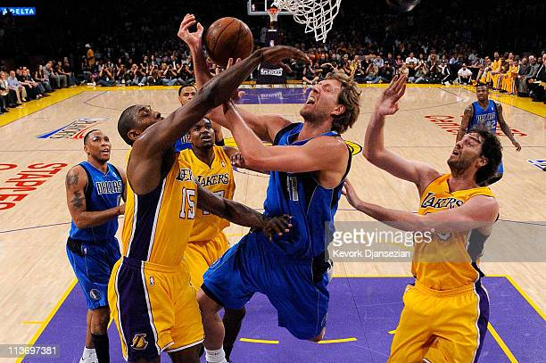 Dirk Nowitzki of the Dallas Mavericks goes up for a shot between Ron Artest and Pau Gasol of the Los Angeles Lakers in the first quarter in Game Two...