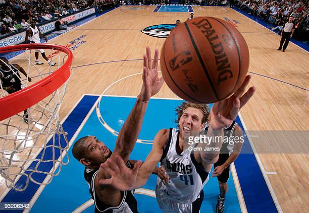 Dirk Nowitzki of the Dallas Mavericks goes up for the layup against Tim Duncan of the San Antonio Spurs during a game at the American Airlines Center...