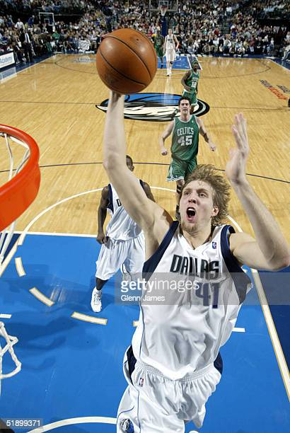 Dirk Nowitzki of the Dallas Mavericks goes up with the ball against the Boston Celtics on December 28 2004 at the American Airlines Center in Dallas...