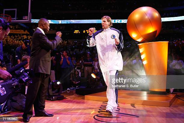 Dirk Nowitzki of the Dallas Mavericks greets head coach Avery Johnson during player introductions against the Miami Heat during Game Two of the 2006...