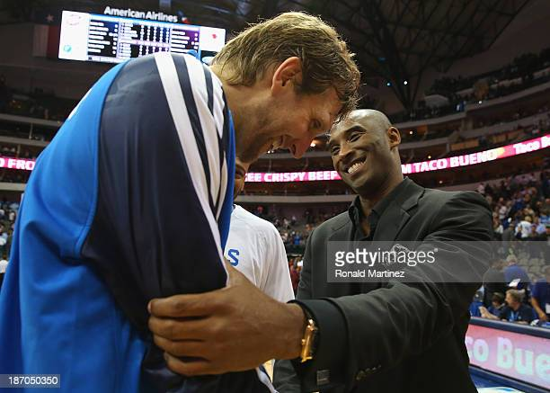 Dirk Nowitzki of the Dallas Mavericks greets Kobe Bryant of the Los Angeles Lakers after a game at American Airlines Center on November 5 2013 in...