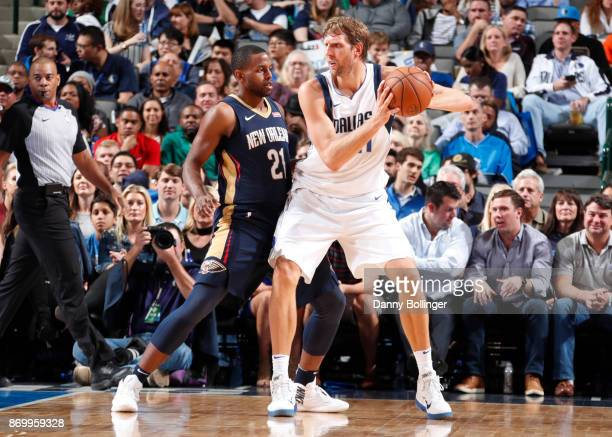 Dirk Nowitzki of the Dallas Mavericks handles the ball against Darius Miller of the New Orleans Pelicans on November 3 2017 at the American Airlines...