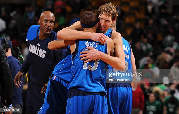Dirk Nowitzki of the Dallas Mavericks hugs team mate Delonte West after the game win against the Boston Celtics on January 11 2012 at the TD Garden...