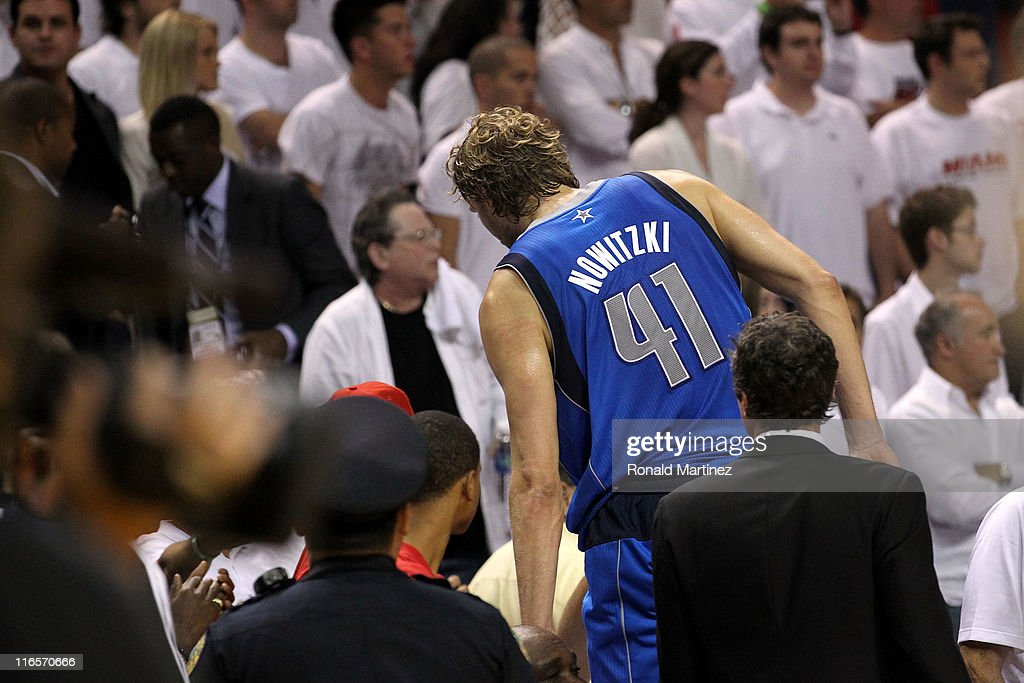 Dirk Nowitzki #41 of the Dallas Mavericks immediately leaves the court as the final buzzer sounds and the Mavericks win 105-95 against the Miami Heat in Game Six of the 2011 NBA Finals at American Airlines Arena on June 12, 2011 in Miami, Florida.