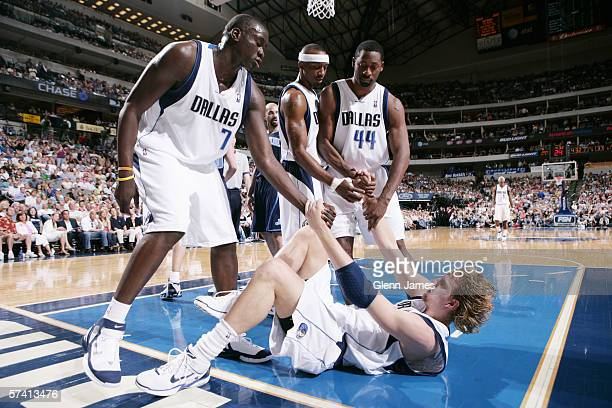 Dirk Nowitzki of the Dallas Mavericks is lifted by teammates during play against the Utah Jazz at American Airlines Arena on April 16 2006 in Dallas...