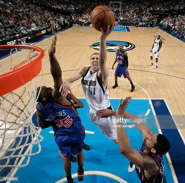 Dirk Nowitzki of the Dallas Mavericks lays it up against Erick Dampier of the New York Knicks on March 30 2007 at the American Airlines Center in...