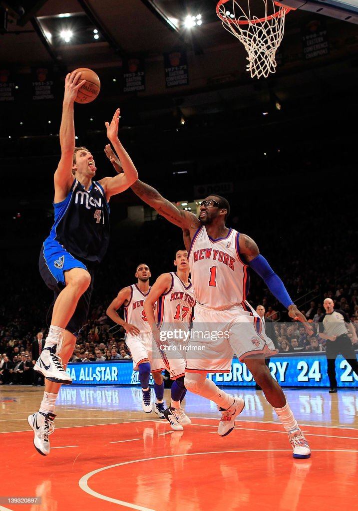 Dirk Nowitzki #41 of the Dallas Mavericks lays the ball up over Amare Stoudemire #1 of the New York Knicks at Madison Square Garden on February 19, 2012 in New York City.