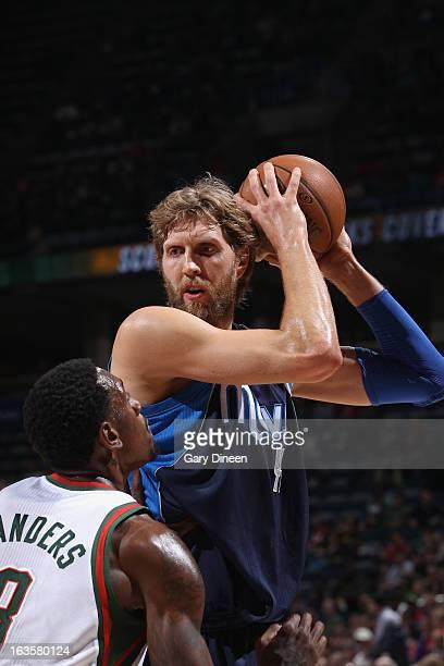 Dirk Nowitzki of the Dallas Mavericks looks to drive against Larry Sanders of the Milwaukee Bucks on March 12 2013 at the BMO Harris Bradley Center...