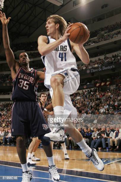 Dirk Nowitzki of the Dallas Mavericks looks to find a team mate to pass to against the New Jersey Nets January 15 2005 at the American Airlines...