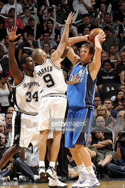 Dirk Nowitzki of the Dallas Mavericks looks to make a pass play against Tony Parker and Antonio McDyess of the San Antonio Spurs in Game Four of the...