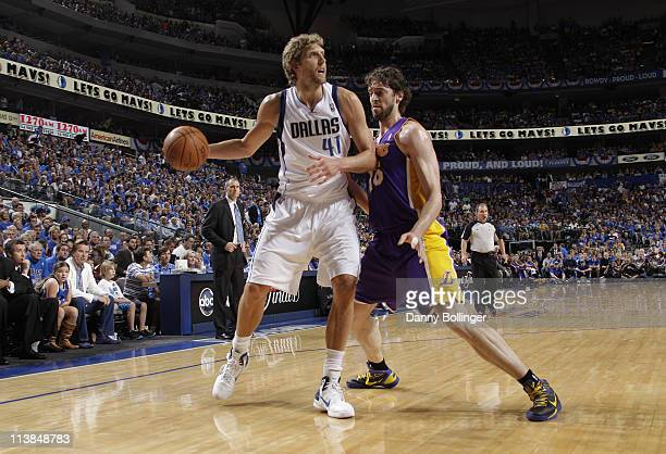 Dirk Nowitzki of the Dallas Mavericks looks to pass against Pau Gasol of the Los Angeles Lakers during Game Four of the Western Conference Semifinals...