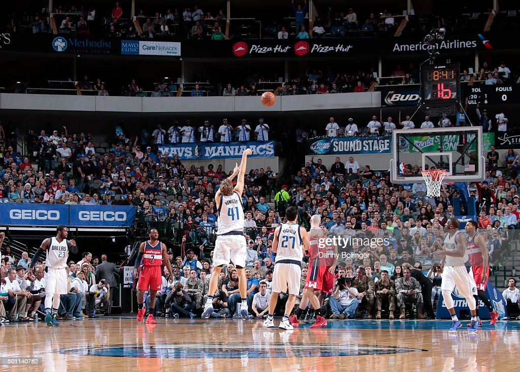 Dirk Nowitzki #41 of the Dallas Mavericks makes a three-pointer which moves him into 16th place on the NBA's All-Time Three-Point shots made list against the Washington Wizards on December 12, 2015 at the American Airlines Center in Dallas, Texas.