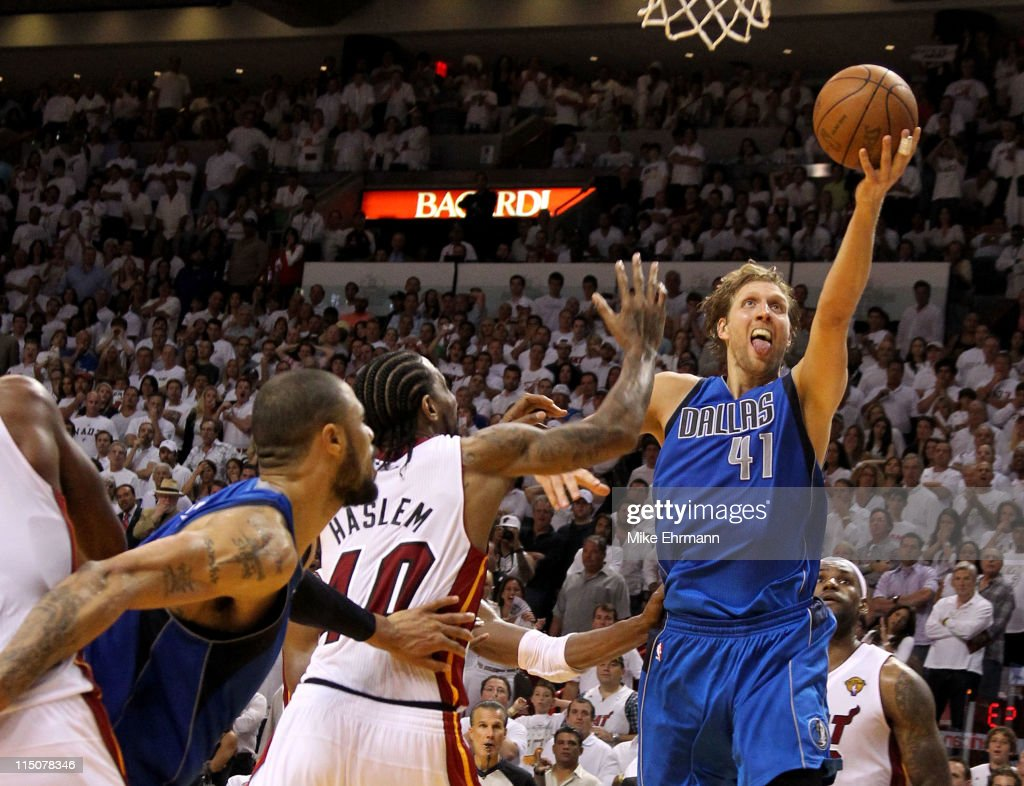 Dirk Nowitzki #41 of the Dallas Mavericks makes the game-winning shot to put the Mavericks up 95-93 with 3.6 seconds left in the game against Udonis Haslem #40 of the Miami Heat in Game Two of the 2011 NBA Finals at American Airlines Arena on June 2, 2011 in Miami, Florida.
