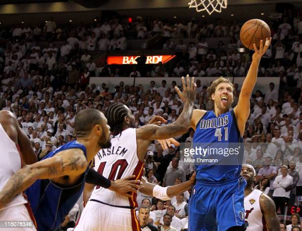 Dirk Nowitzki of the Dallas Mavericks makes the gamewinning shot to put the Mavericks up 9593 with 36 seconds left in the game against Udonis Haslem...