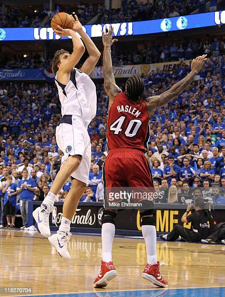 Dirk Nowitzki of the Dallas Mavericks misses a lastsecond shot over Udonis Haslem of the Miami Heat as the Mavericks were defeated 8886 in Game Three...