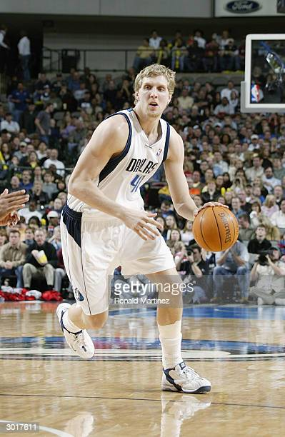 Dirk Nowitzki of the Dallas Mavericks moves the ball during the game against the Houston Rockets on February 21 2004 at American Airlines Center in...