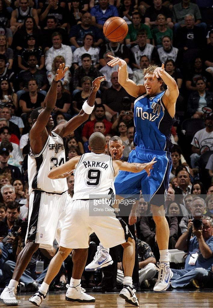 Dirk Nowitzki #41 of the Dallas Mavericks passes against Antonio McDyess #34 and Tony Parker #9 of the San Antonio Spurs in Game Four of the Western Conference Quarterfinals during the 2010 NBA Playoffs at AT&T Center on April 25, 2010 in San Antonio, Texas. The Spurs won 92-89.