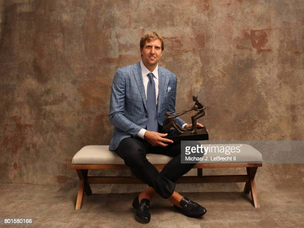 Dirk Nowitzki of the Dallas Mavericks poses for a portrait after receiving the TwymanStokes Teammate of the Year Award at the NBA Awards Show on June...