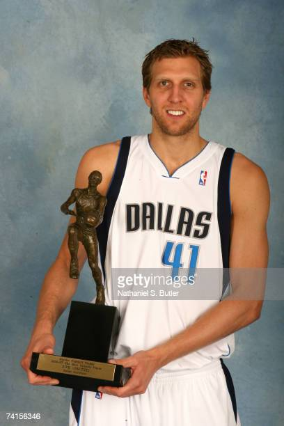 Dirk Nowitzki of the Dallas Mavericks poses for a portrait with the Maurice Podoloff 2006-2007 NBA MVP Trophy during the award presentation on May...