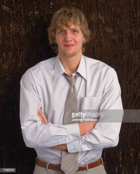 Dirk Nowitzki of the Dallas Mavericks poses for a studio portrait on January 2 2002 in Dallas Texas NOTE TO USER User expressly acknowledges and...