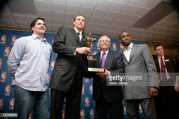 Dirk Nowitzki of the Dallas Mavericks poses with the NBA MVP trophy and Mark Cuban David Stern and Avery Johnson at the American Airlines Center on...